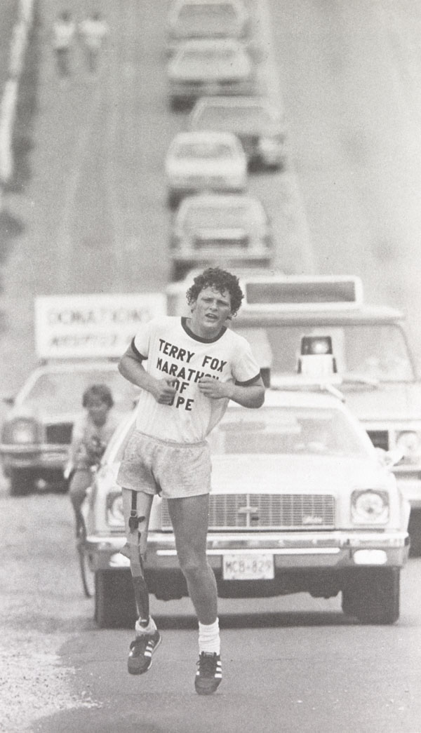 Photograph of Terry Fox  running along a roadway with a police car and    Terry Fox Poster