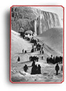 Photograph of people engaged in winter activities at the frozen Niagara Falls, Ontario, 1875