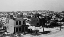 Photograph of the view from the Willis Foundry after the explosion, showing a large pile of rubble, Halifax, 1917