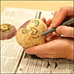 Photograph showing step 3 of how to make a carved turnip head