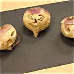 Photograph showing three carved turnip heads
