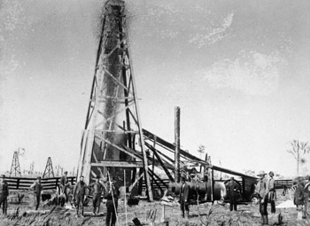 Photograph of an oil well being torpedoed at Petrolia, Ontario, 1886