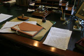 Photograph of documents and miscellaneous items on a desk in the office of Sir�John�A.�Macdonald in the East Block of Parliament, 2007