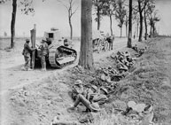 Photograph of Canadian troops taking cover in a ditch alongside the road from Arras to Cambrai.