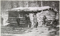 NWMP members by shack, at end of CPR tracks, Golden, B.C., 1886