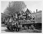 Photograph of Dutch women and children sitting on a Sherman VC Firefly tank of Lord Strathcona�s Horse (Royal Canadians). Harderwijk, Netherlands, April 19, 1945. Photograph by Captain Jack H. Smith.