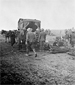 Photograph of a horse ambulance collecting wounded soldiers at an advanced Field Dressing Station, the Somme (Fler-Courcelette), September 15, 1916