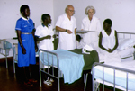 Photograph of Dr. Lucille Teasdale and husband Dr. Piero Corti on rounds in new tuberculosis ward
