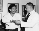 Photograph of Dr. Gustave Gingras and patient Benedicto Santos Ramirez at the Rehabilitation Institute of Montreal