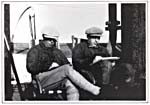 Photograph of A.Y. Jackson and Dr. Frederick Banting sketching aboard the S. S. BEOTHIC during their Arctic voyage, 1927