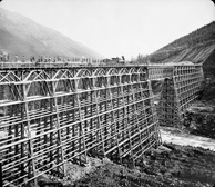 Photograph of a wooden railway bridge over Mountain Creek, British Columbia, circa 1880-1890